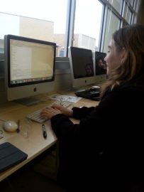 Allegra working on the code for our website.